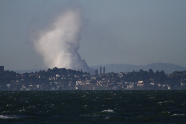 The U.S. Chemical Safety Board released this photo of a white vapor cloud above the Chevron refinery in Richmond, caught fire. Photo by Fototaker.net