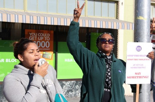 Oakland residents at a SAVE coalition rally chant to honor a man killed at this intersection last fall. Photo credit: Ingrid Becker