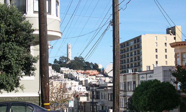 """"""" ... from outside 900 Lombard we see the same view today plus an unsightly apartment building blocking the distant twin spires of Sts. Peter and Paul church on Washington Square."""" (Courtesy Reel SF)"""