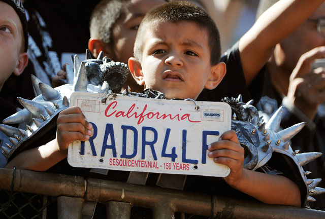 A young Raiders fan during a 2011 game in Oakland. (Thearon W. Henderson/Getty Images)