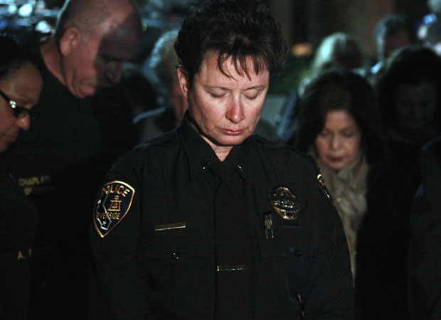 Police officers and residents gather Thursday night at Riverside City Hall to remember Riverside Police Department officer allegedly slain by Christopher Dorner. (Steven Cuevas/KQED)
