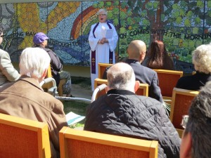 Rev. Kathryn Pike dedicates the new mosaic mural at Bethany Presbyterian Church. Three of the eight people who died in the fire were members of the church. (Francesca Segre/KQED)