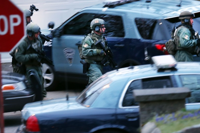 Members of a police S.W.A.T. team run to the scene where it was believed 19-year-old bombing suspect Dzhokhar A. Tsarnaev is in hiding on April 19, 2013 in Watertown, Massachusetts. (Spencer Platt/Getty Images)