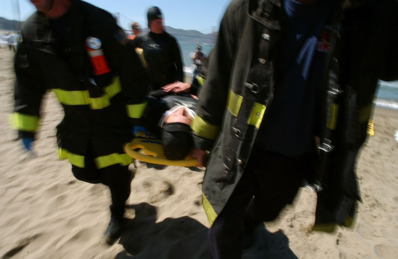 Members of the San Francisco Fire and Police Departments, the National Park Service, United States Coast Guard, California Highway Patrol, Presidio Fire Department, and San Mateo Harbor Patrol take part in a Aquatic Multi-Casualty Exercise in the San Francisco Bay. (David Paul Morris/Getty Images)