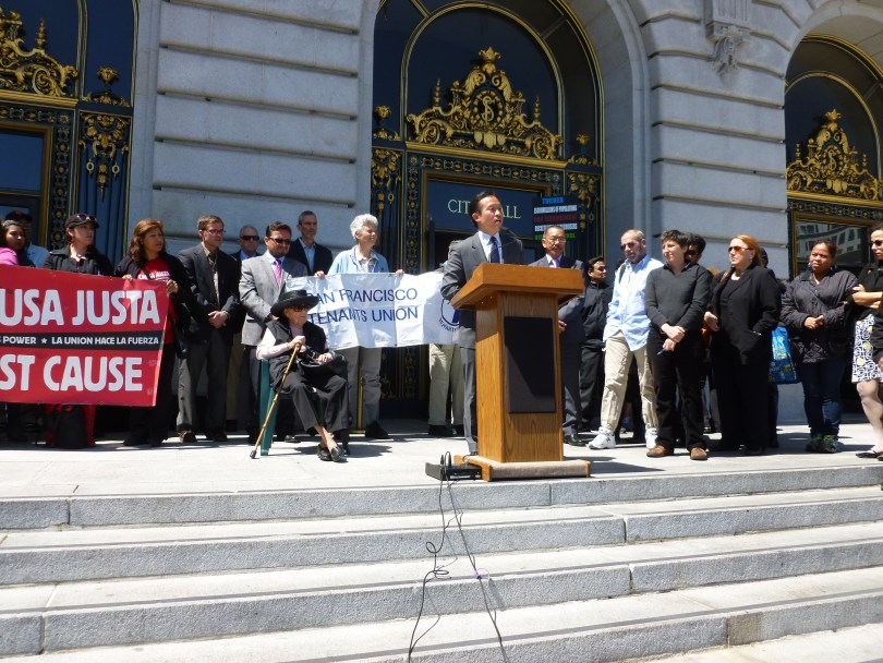San Francisco Board of Supervisors President David Chiu presents his new TIC proposal alongside tenants' rights groups and Mary Phillips, a 97-year-old facing eviction. (Sam Harnett/KQED)