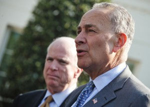Senator Chuck Schumer, D-NY, speaks to reporters as Senator John McCain (L), R-AZ, looks on after a meeting with US President Barack Obama to brief him on the draft of a bipartisan immigration reform bill outside of the West Wing of the White House on April 16, 2013 in Washington, DC. (Mandel Ngan/AFP/Getty Images)