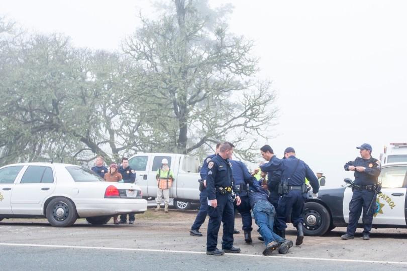 Police take William Parrish and Sara Grusky into custody. (Steve Berhard/The Willits News)