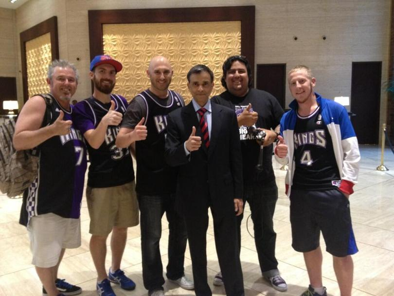 Prospective Kings owner Vivek Ranadive poses with Kings fans who came from Sacramento to Dallas for the NBA meeting. (Kevin Fippin)