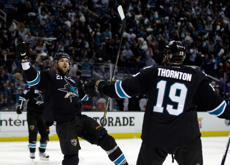 Joe Thornton (No. 19) congratulates T.J. Galiardi (No. 21) of the San Jose Sharks after Galiardi scored a goal in game 6 of the Western Conference Semifinals during the 2013 Stanley Cup Playoffs at HP Pavilion (Ezra Shaw/Getty Images)
