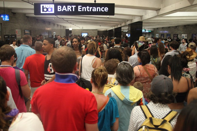 Crowds from San Francisco's LGBT Pride celebration throng BART's Civic Center station on Sunday. (KQED/Deb Svoboda)