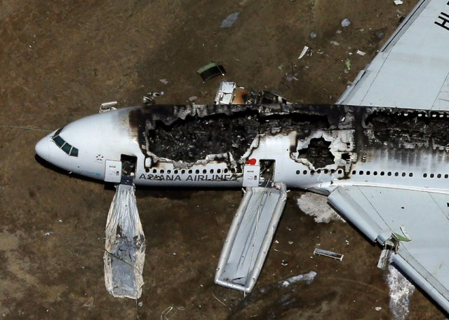 Asiana Airlines Flight 214 lies burned on the runway after it crashed  at San Francisco International Airport in July. (Ezra Shaw/Getty Images)