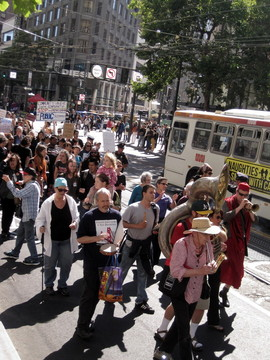 More than 1,000 people marched on Market St. to the Federal Department of Education's SF offices to demand that they save City College of San Francisco from losing its accreditation. (Rachael Marcus/KQED)