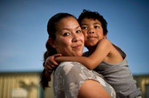 Crystal Nguyen, with her 6-year-old son, Neiko, in Pittsburg, Calif., is a former Valley State Prison for Women inmate. She worked in the prison's infirmary in 2007 and says she often overheard medical staff asking inmates who had served multiple prison terms to agree to be sterilized. (Noah Berger for The Center for Investigative Reporting)