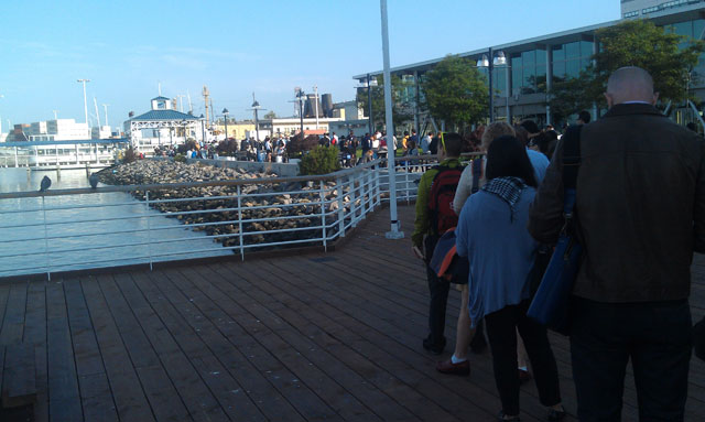 Commuters wait in line at the the Jack London Square Ferry Terminal in Oakland on July 2, 2013. (Andrew Stelzer/KQED)