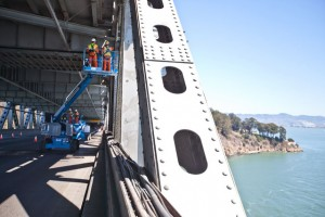 While the new eastern span of the bay bridge is being put into place, the western span was covered with maintenance workers over the weekend. (Deborah Svoboda/KQED)