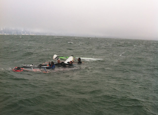 The group of windsurfers who found this dog swimming in the bay on Aug. 12(Courtesy of Adam Cohen)