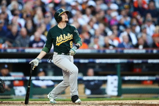 A's shortstop Jed Lowrie follows the flight of the ball as he homers in the fifth inning of Tuesday's game. (Leon Halip/Getty Images)