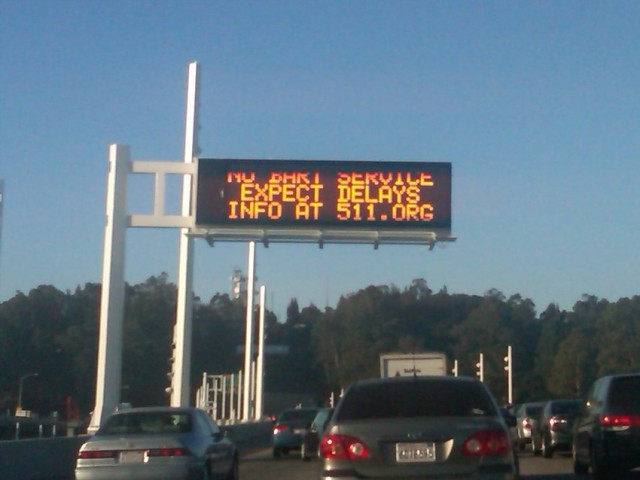 On Friday, Oct. 18, a sign on the Bay Bridge warns commuters to expect traffic because of no BART service. (Ellen Barkenbush/KQED)