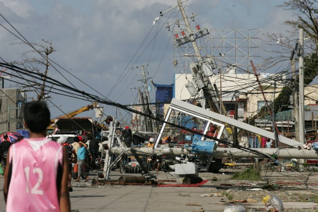 Typhoon Haiyan wrecked Tacloban, a city of about 200,000 people on the Philippines island of Leyte. (Photo by Jeoffrey Maitem/Getty Images)