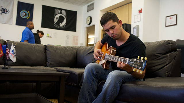 Edwin del Rio waited two years for the Department of Veterans Affairs to resolve his disability claim. When he received a $31,000 retroactive benefits check, he used some of it to buy a new electric guitar and pay off debt. (Monica Lam/KQED)