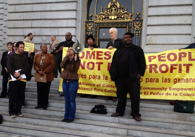 Tenants facing evictions hold a rally outside San Francisco City Hall Thursday (Bryan Goebel/KQED)