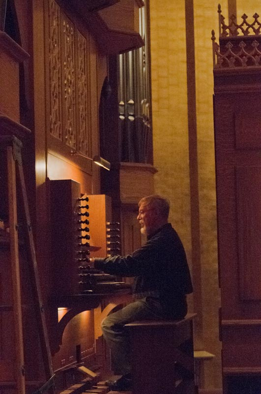 """Fritz Noack works on the final """"voicing"""" of the organ."""