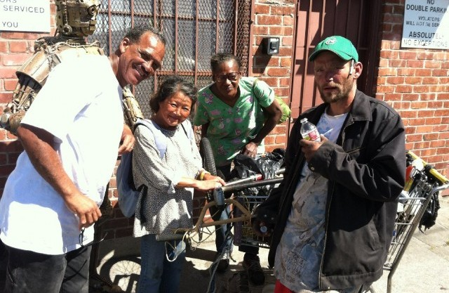 """A group of West Oakland recyclers featured in Amir Soltani's """"Dogtown Redemption."""" (Image Copyright 2013, Redemption)."""