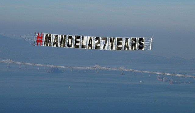 Pilots from the Tuskegee Airmen Inc. nonprofit flew over the Bay Area Saturday in a tribute to Nelson Mandela. (Tawanda Kanhema)