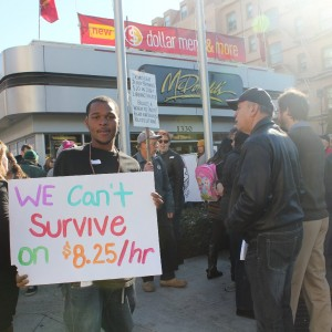 A protester at a fast-food wage protest in Oakland in early December. They are asking for $15 and the right to form a union. (Sara Hossaini/KQED)