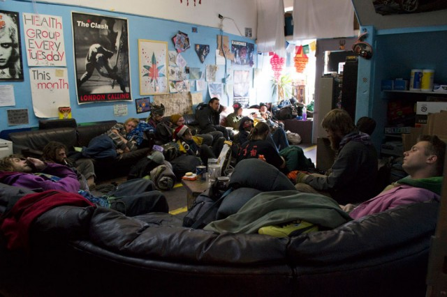 Homeless youth rest and watch television at the Homeless Youth Alliance on Dec. 18, 2013, seven days before the organization has to close its doors to prepare to move everything into storage. (Sara Bloomberg/KQED)