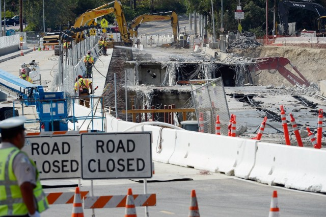 """Construction crews on I-405 in Los Angeles in September 2012 during the second of two """"Carmageddon"""" closures designed to facilitate work on the freeway. (Getty Images/Kevork Djansezian)"""