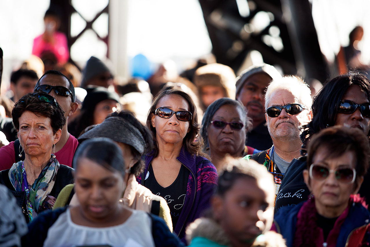 Participants in the Martin Luther King Jr. Day march in San Francisco listen to speeches from religious leaders.