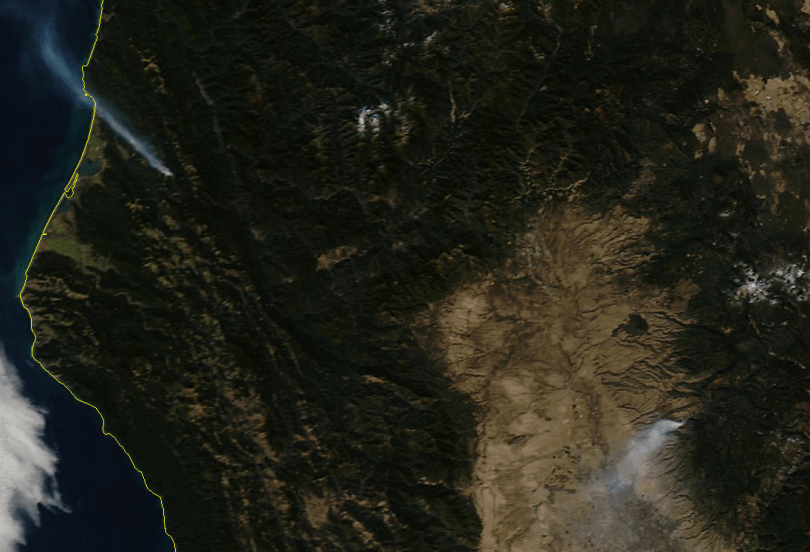 A NASA satellite image shows fires burning over the weekend in Humboldt County (left) and Lassen County (right). (NASA/University of Wisconsin)