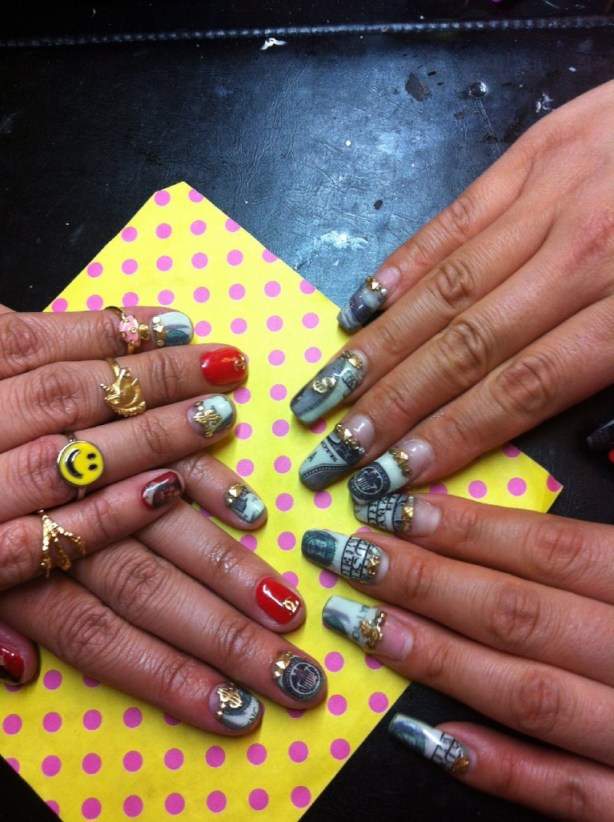 Nail artist Britney Tokyo gives friend and client Roxy Ferrari a manicure using a few Cha Cha Cover decals, paint and charms. (Caitlin Esch/KQED)