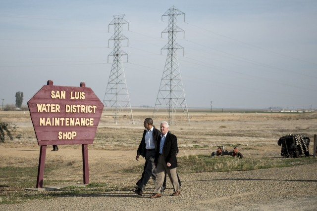 President Obama and San Joaquin Valley Congressman Jim Costa walk to a meeting with local residents in the Fresno County town of Firebaugh. (Brendan Smialowski/AFP/Getty Images)