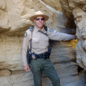 Ranger Steve Bier stands at the entrance to The Slot, a narrow canyon in the Anza-Borrego backlands. (Lisa Morehouse/KQED).