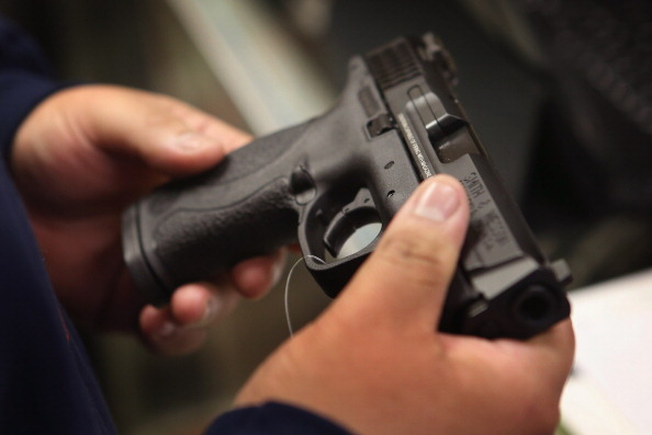 A customer shops for a pistol at Freddie Bear Sports sporting goods store on December 17, 2012 in Tinley Park, Illinois. (Scott Olson/Getty Images)