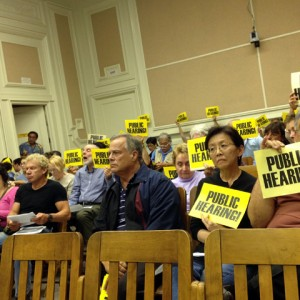 Neighbors and merchants — including Mokka owners Susan and Michael Iida, front row, right —  turned out to a zoning board meeting on Nov. 19, 2013 to request a public hearing over the proposed Starbucks at Ashby and Telegraph avenues in Berkeley. (Emilie Raguso/Berkeleyside)