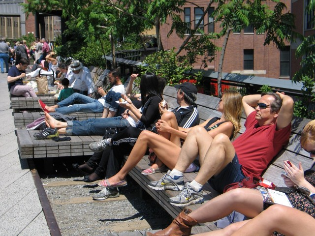 These people relaxing along the High Line in New York in May 2012 are in no rush to get anywhere. (Patricia Yollin/KQED)