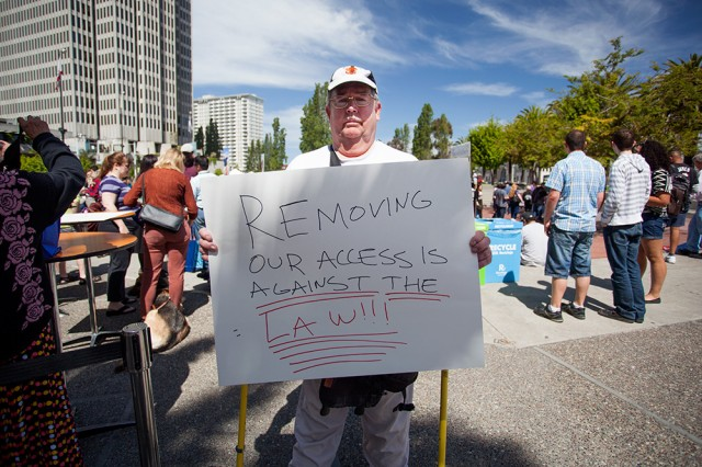 Bob Planthold attended the unveiling to protest the new cars' perceived lack of accessibility (Mark Andrew Boyer/KQED)