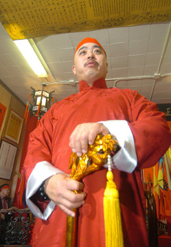 "In this photo taken Aug. 6, 2006, Raymond ""Shrimp Boy"" Chow is shown after being sworn in as the ""Dragon Head"" of the Ghee Kung Tong in Chinatown in San Francisco. Investigators say Chow is the leader and the dragonhead of one of the most powerful Asian gangs in North America. Chow's gang is said to have lured state Sen. Leland Yee into its clutches through money and campaign contributions in exchange for legislative help, as Yee sought to build his campaign coffers to run for California secretary of state. Born in Hong Kong in 1960, Chow came to the United States at 16 and was reportedly nicknamed ""Shrimp Boy"" by his grandmother, in part due to his small stature. (AP Photo/Sing Tao Daily)"