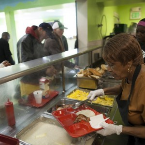 Volunteers serve breakfast to those in need at Mother Brown's Dining Room. (Mark Andrew Boyer/KQED)