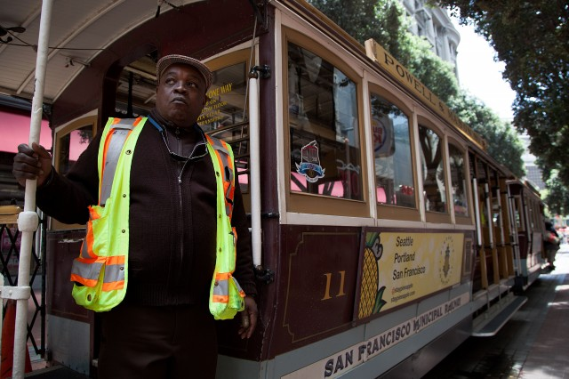 Trolley conductor Sam Eversley gazes up Powell Street. (Mark Andrew Boyer/KQED)