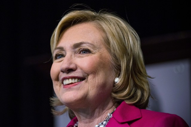 "Former Secretary of State Hillary Clinton speaks to a crowd during a book signing for her new book, ""Hard Choices"" in New York earlier this month. (Andrew Burton/Getty Images)"