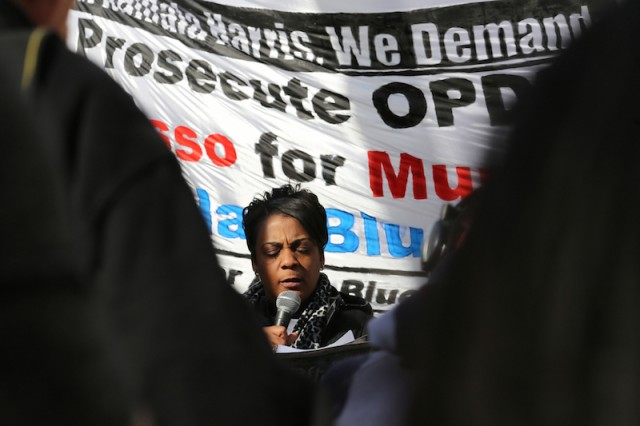 Jeralynn Blueford, shown speaking at a rally in March 2013, has helped create a foundation that is a resource for victims of police abuse. Her son Alan was shot and killed by an OPD officer in 2012. (Daniela Kantorova/Flickr)