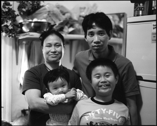 Family living in a residential hotel in Chinatown, San Francisco. (James Hosking and Jeremy Lybarger/The Bold Italic)