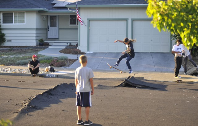 Kids skateboard over buckled roads in a residential neighborhood of Napa, California. (Josh Edelson/AFP/Getty Images)