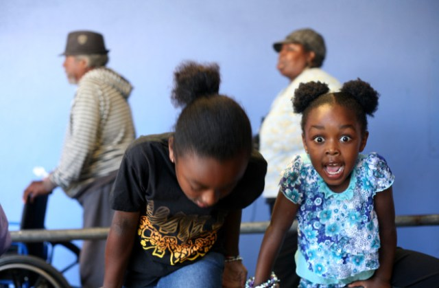 Oakland children wait in line at the St. Vincent de Paul meal program. (Anna Vignet/Oakland Local)