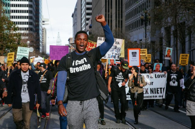 Thousands protesting police brutality marched down Market street in San Francisco on Saturday December 13, 2014. (Jeremy Raff/KQED)