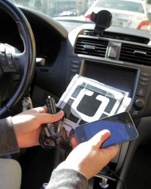 UberX drivers receive a company phone and emblem after signing up. (Jeremy Raff/KQED)